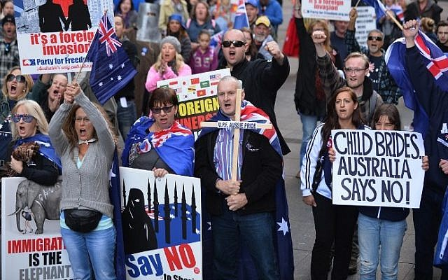 Nationalist demonstrators protest at a rally against Islamic extremism in Sydney, Australia on July 19, 2015. ( AFP PHOTO / Peter Parks)