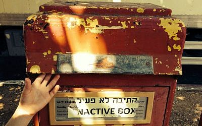 One of Jerusalem's hundreds of red mailboxes rendered inactive, at least for now (Photo credit: Jessica Steinberg)