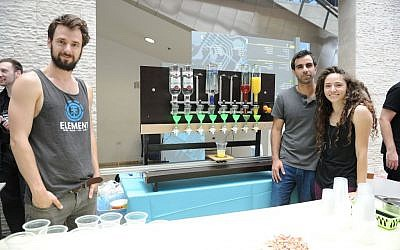 From left to right: RoboDrink inventors Zorik Gechman, Michal Friedman and Yoav Mizrahi  (Courtesy)