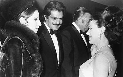 In this Jan. 15, 1969 file photo, Britain's Princess Margaret, right, talks with American singer Barbra Streisand, left, and actor Omar Sharif, center, at the premiere of the film 'Funny Girl,' at the Odeon Cinema, London. (AP Photo, File)