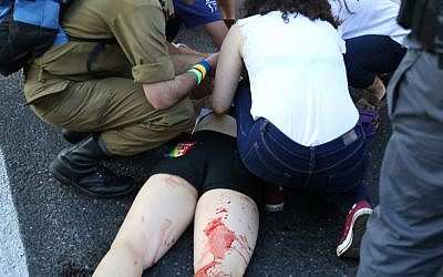 An injured woman after a stabbing at the annual Jerusalem Pride Parade on July 30, 2015. (Eric Cortellessa/Times of Israel)