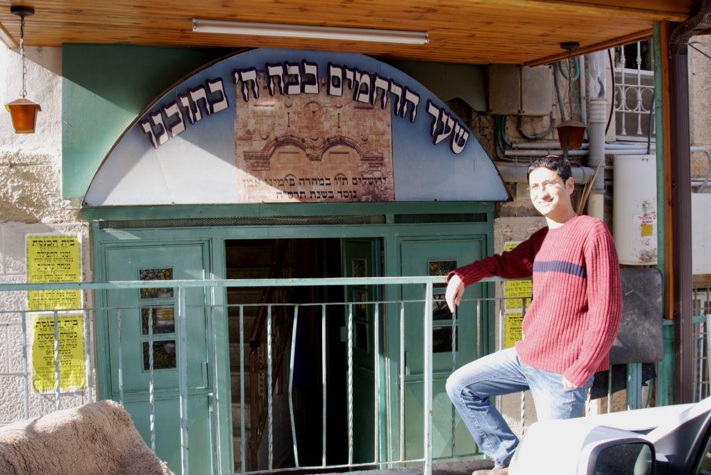Tal Chenya stands outside Shaare Rahamim Bana Hai Synagogue, home of the mystics (Shmuel Bar-Am))