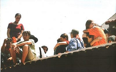 Noam Tashnady, 12 (seated), during the Gaza disengagement in August 2005 (Courtesy)
