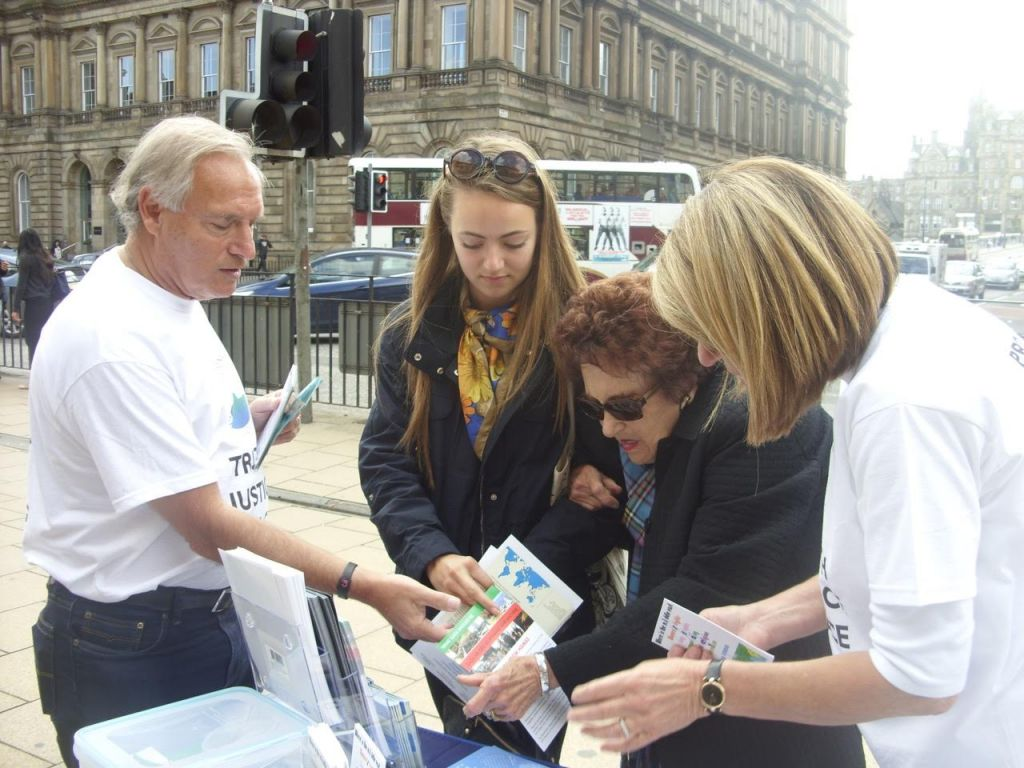 Volunteers from the Edinburgh Friends of Israel hand out Israel advocacy material, including flyers from the Zionist Federation and informative booklets from StandWithUs. (courtesy)