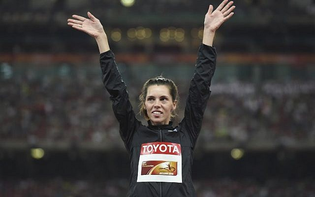 Israel's Hanna Knyazyeva-Minenko celebrates her silver medal on the podium during the victory ceremony for the women's triple jump athletics event at the 2015 IAAF World Championships at the 'Bird's Nest' national stadium in Beijing on August 24, 2015 (AFP PHOTO / GREG BAKER)