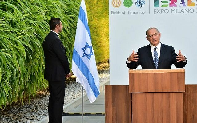 Prime Minister Benjamin Netanyahu delivers a speech as a security guard stands near him during a visit at the Universal Exhibition 2015 (Expo Milano 2015 or World Exposition 2015) in Milan on August 27, 2015. (Giuseppe Cacace/AFP)