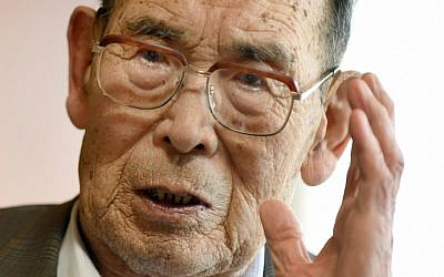In this photo taken on June 25, 2015, former Japanese fighter pilot Kaname Harada, 98, gestures as he tells his experience during World War II at his home in Nagano, Japan. (AFP Photo/Toru Yamanaka)