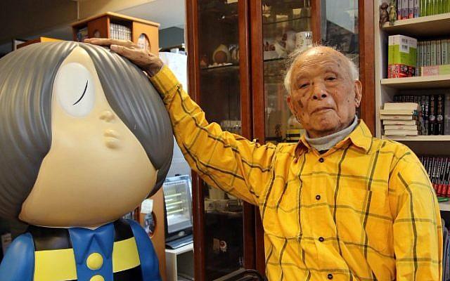 "This picture taken on May 12, 2015 shows Japanese 93-year-old comic artist Shigeru Mizuki showing his famous character ""Kitaro"" as he speaks at his studio in Tokyo. (AFP Photo/Yoshikazu Tsuno)"