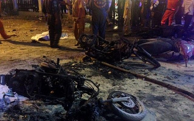 Destroyed motorbikes pictured at the scene of devastation after a bomb exploded outside a religious shrine in central Bangkok, August 17, 2015.  (AFP/AIDAN JONES)