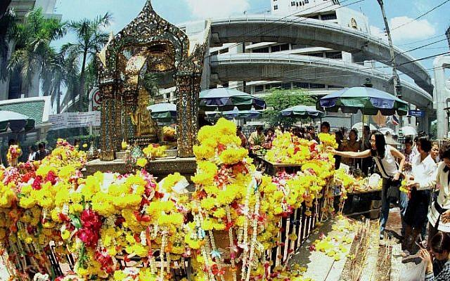 This file photo taken on September 9, 1999 shows tourists paying homage to the Erawan Shrine in central Bangkok. (AFP Photo/file/Pornchai Kittiwongsakul)