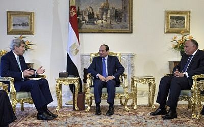 Egypt's President Abdel-Fattah el-Sissi (center), and his Foreign Minister Sameh Shukri (right), listen to US Secretary of State John Kerry (left), speaking before a meeting at the presidential palace, Cairo, Egypt, August 2, 2015. (AFP/Brendan Smialowski/Pool)
