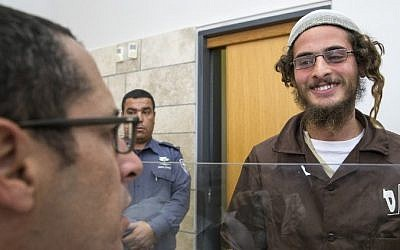 Meir Ettinger, the alleged head of a Jewish extremist group, at the Magistrate's Court in Nazareth Illit on August 4, 2015, a day after his arrest. (AFP/Jack Guez)