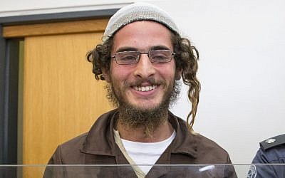Meir Ettinger, the head of a Jewish extremist group, stands at the Israeli justice court in Nazareth Illit on August 4, 2015. (AFP PHOTO / JACK GUEZ)