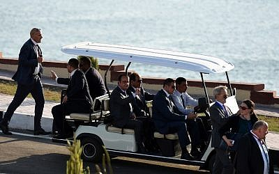 Egyptian President Abdel-Fattah el-Sissi and French President Francois Hollande ride on a cart during the opening ceremony of a new waterway at the Suez Canal on August 6, 2015, in the port city of Ismailiya. (AFP PHOTO/ MOHAMED EL-SHAHED)