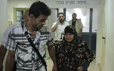 Maazouze Allaan (R), the mother of Palestinian prisoner Mohammed Allaan, walks outside her son's room following a visit to the Barzilai Medical Center in the Israeli city of Ashkelon on August 20, 2015. (Ahmad Gharabli/AFP)