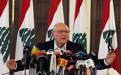 Lebanese Prime Minister Tammam Salam speaks during a press conference on August 23, 2015 at the Grand Serail, his headquarters in the capital Beirut, a day after clashes erupted between Lebanese security forces and demonstrators calling for a solution to weeks of uncollected rubbish. (AFP PHOTO / ANWAR AMRO)