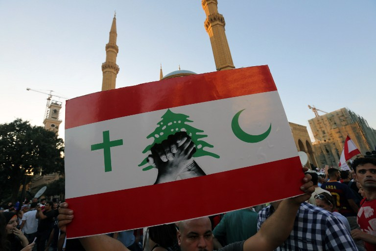 Tens of thousands march in Beirut 'You Stink' protest against ...