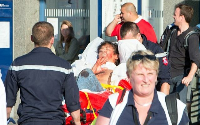 An injured man is carried away on a stretcher from the train station of Arras, northern France, after being injured on August 21, 2015 when a gunman opened fire on a train travelling from Amsterdam to Paris. A heavily armed man opened fire on a high-speed train travelling from Amsterdam to Paris. (AFP PHOTO / STRINGER)