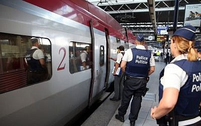 Police officers stand on the platform at the Zuid-Midi railway station in Brussels, on August 22, 2015, a day after a shooting occurred on board an Amsterdam-Paris Thalys train (AFP/BELGA/Nicolas Maeterlinck)