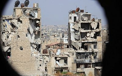 A general view taken from Aleppo's Syrian regime-controlled neighborhood of Karm al-Jabal shows heavily damaged buildings on July 30, 2015. (AFP/George Ourfalian)