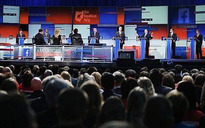 Guests watch Republican presidential candidates speak during the first Republican presidential debate hosted by Fox News and Facebook in Cleveland, Ohio, on August 6, 2015. (Scott Olson/Getty Images/AFP)