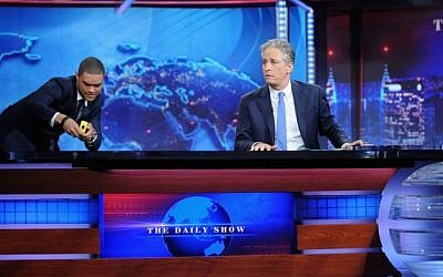 "Trevor Noah and host Jon Stewart appear on ""The Daily Show with Jon Stewart"" on August 6, 2015 in New York City.  (Brad Barket/Getty Images for Comedy Central/AFP)"