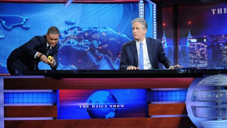 """Trevor Noah and host Jon Stewart appear on """"The Daily Show with Jon Stewart"""" on August 6, 2015 in New York City.  (Brad Barket/Getty Images for Comedy Central/AFP)"""