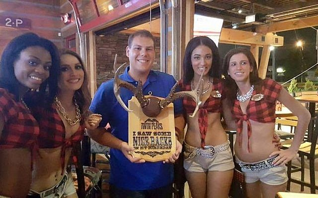"""Matthew Kuppe (center) in a Facebook post dated Aug. 9, 2015 with the caption, """"This is how you celebrate 21!"""" (Screen capture Facebook)"""