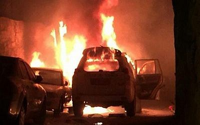 Illustrative: A Border Police car on fire after Palestinians threw a Molotov cocktail at the vehicle, in Jerusalem on Wednesday, August 26, 2015. (Screen capture)