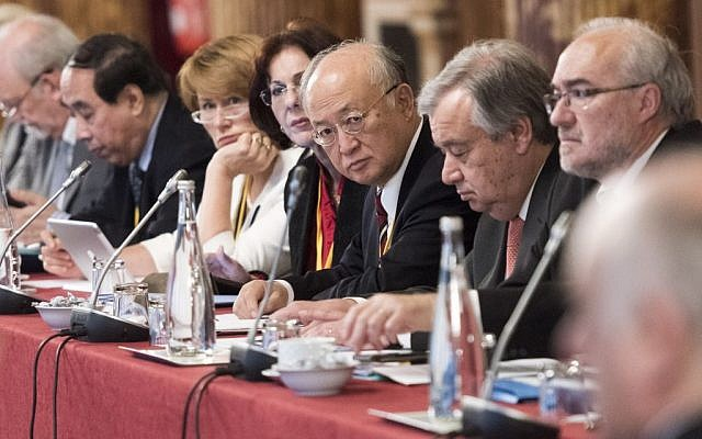 Yukiya Amano, center, attending an IAEA meeting in Paris in April 2015. (UN/Mark Garten)