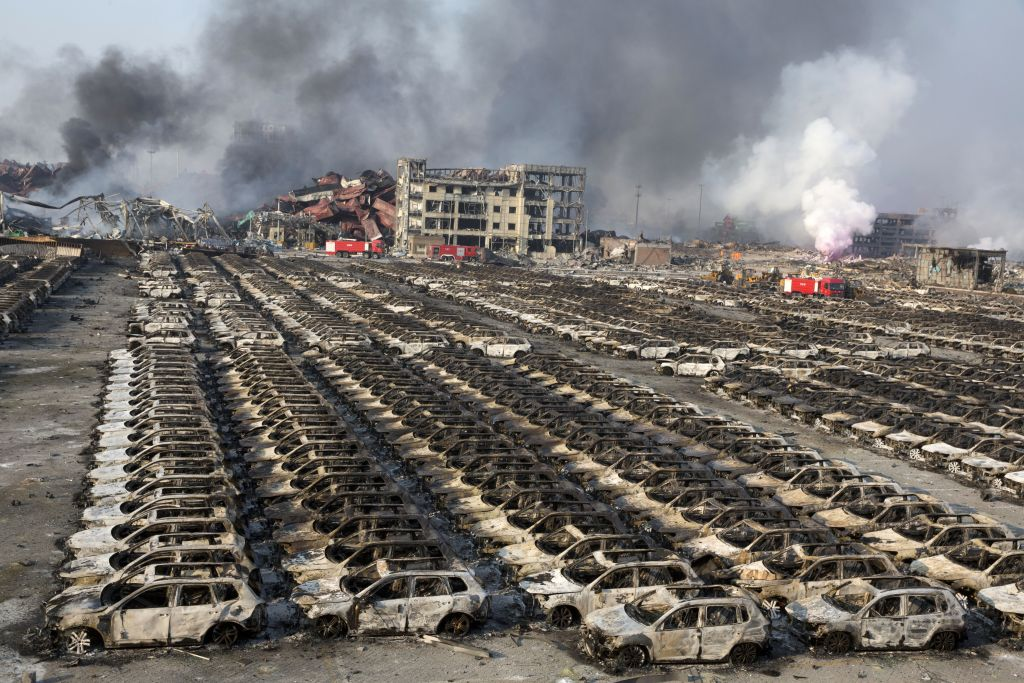 China blasts death toll hits 85 as firefighters battle blaze