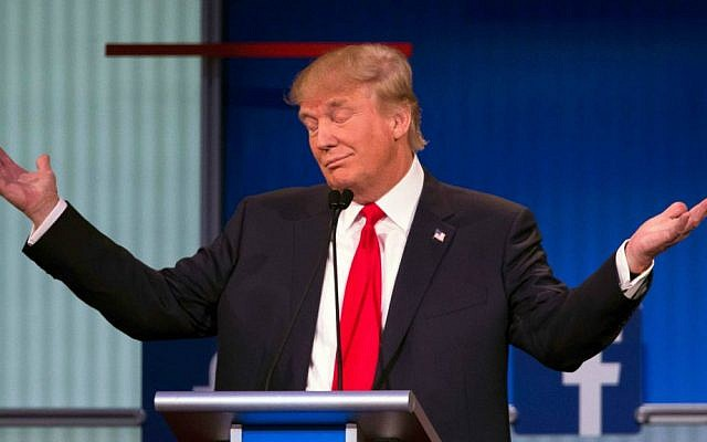 Republican presidential candidate Donald Trump gestures during the first Republican presidential debate at the Quicken Loans Arena Thursday, August 6, 2015, in Cleveland. (AP Photo/John Minchillo)