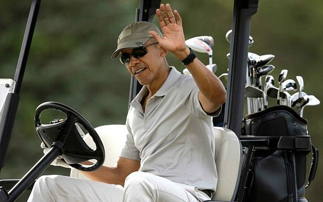 President Barack Obama waves to bystanders from his golf cart while golfing Saturday, Aug. 8, 2015, at Farm Neck Golf Club, in Oak Bluffs, Massachusetts, on the island of Martha's Vineyard. (AP Photo/Steven Senne)