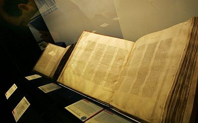A Codex Sinaiticus manuscript, right, the earliest complete New Testament, from 4th century Egypt or Judea on display in the 'Sacred : Discover what we share' exhibition at the British Library in London, Wednesday, April 25, 2007 (AP Photo/Sang Tan)
