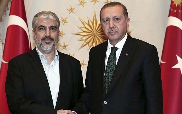 Turkey's President Recep Tayyip Erdogan, right, shakes hands with Hamas leader Khaled Mashal, left, prior to their meeting at the presidential palace in Ankara, Turkey, August 12, 2015 (AP/Press Presidency Press Service)