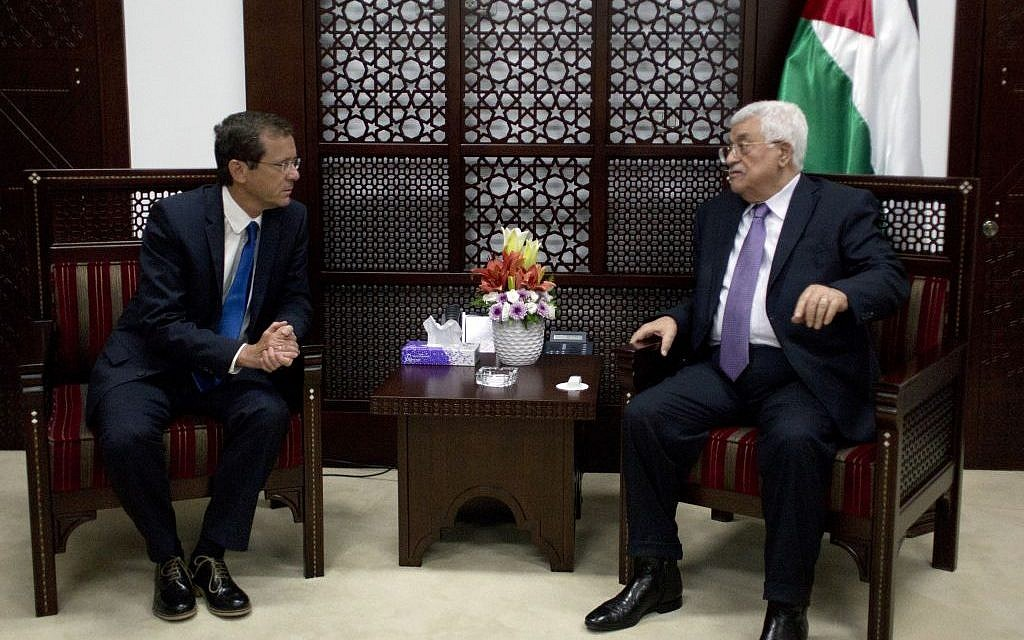 Palestinian Authority President Mahmoud Abbas, right, meets with Zionist Union leader Isaac Herzog, at the president's office in the West Bank city of Ramallah, August 18, 2015. (AP Photo/Nasser Nasser)