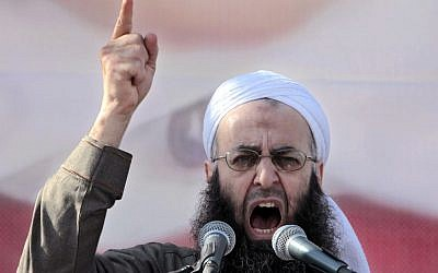 FILE - In this March 4, 2011, file photo, Sheikh Ahmad al-Assir, a Lebanese anti-Syrian regime leader, addresses his supporters during a demonstration against Syrian President Bashar Assad at the Martyrs square in Beirut, Lebanon. (AP Photo/Hussein Malla,File)