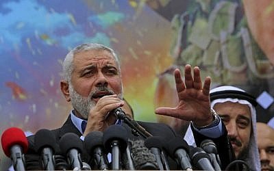 Palestinian top Hamas leader Ismail Haniyeh makes a speech to his supporters during a rally to commemorate the 27th anniversary of the Hamas militant group, at the main road in Jebaliya in the northern Gaza Strip, December 12, 2014 (AP/Adel Hana)