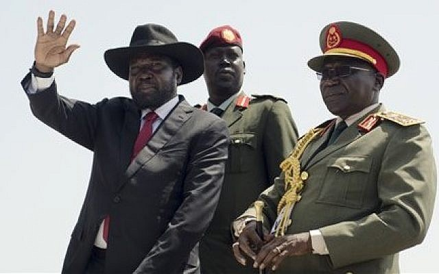 South Sudan's President Salva Kiir, left, accompanied by army chief of staff Paul Malong Awan, right, in the capital Juba, South Sudan, Thursday, July 9, 2015. (Jason Patinkin/AP)