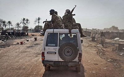 South Sudanese government forces ride on a vehicle, January 12, 2014. (AP/Mackenzie Knowles-Coursin, File)
