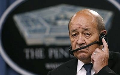 French Defense Minister Jean-Yves Le Drian listens to translation during a joint news conference with Defense Secretary Ashton Carter at the Pentagon, Monday, July 6, 2015. (Carolyn Kaster/AP)