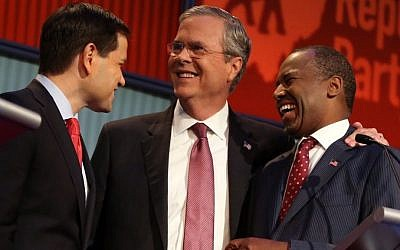 Republican presidential candidates (from left) Marco Rubio, Jeb Bush and Ben Carson talk during a break during the first Republican presidential debate at the Quicken Loans Arena in Cleveland, Thursday, Aug. 6, 2015. (AP Photo/Andrew Harnik)