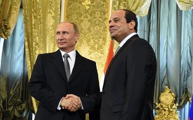 Russian President Vladimir Putin, left, greets Egyptian President Abdel-Fattah el-Sissi in Moscow, Russia, August 2015. (Mohammed Abdel Moatey/MENA via AP)