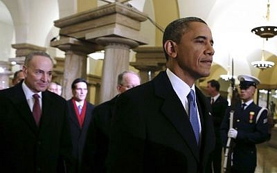 President Barack Obama, followed by Sen. Charles Schumer, D-N.Y., walks through the Capitol in Washington, Monday, Jan. 21, 2013, for his ceremonial swearing-in ceremony during the 57th Presidential Inauguration. (AP Photo/Molly Riley, Pool)