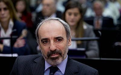 Former Judge Juan Jose Galeano attends a trial where he and others are accused of derailing an investigation into the 1994 bombing of the Argentina Jewish Center in Buenos Aires, Argentina, Thursday, August 6, 2015. (AP Photo/Natacha Pisarenko)