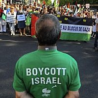 Protesters shout slogans during a rally in Paris, France, June 3, 2010, as they demonstrate against Israel's raid on a Gaza-bound aid ship; a man in the foreground wears a T-shirt calling for a boycott on Israel. (Jacques Brinon/ AP /File)