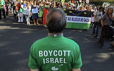 Protesters shout slogans during a rally in Paris, France, Thursday, June 3, 2010, as they demonstrate against Israel's raid on a Gaza-bound aid ship; a man in the foreground wears a T-shirt calling for a boycott on Israel. (Jacques Brinon/ AP)