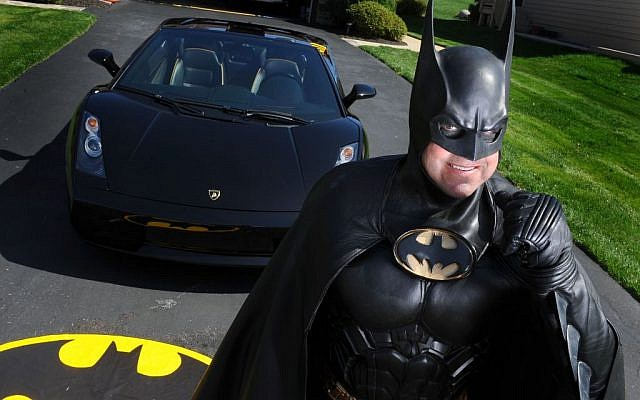 In this March 27, 2012, photo, Leonard Robinson, dressed as Batman, poses for a photo outside his home, in Owings Mills, Md. (Jonathan Newton/The Washington Post via AP)