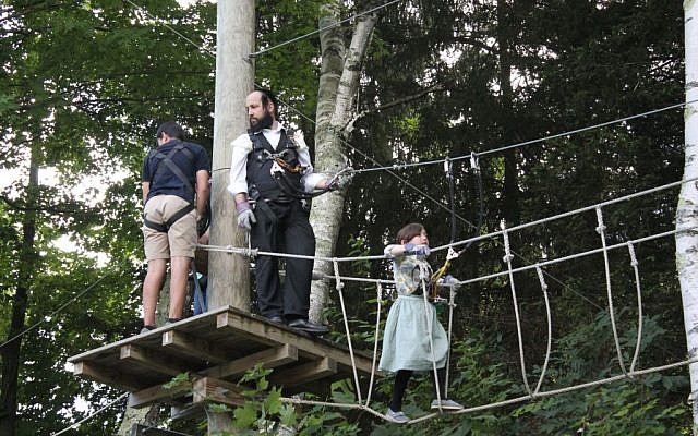 Visitors on a ropes course  at Jiminy Peak in August 2015. (JTA/Uriel Heilman)