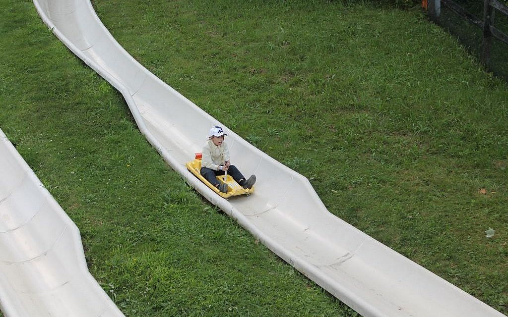 A child whips down an alpine slide at Jiminy Peak in August 2015. (JTA/Uriel Heilman)